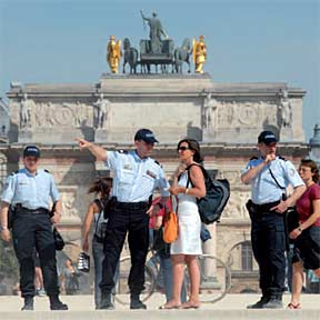 Paris police assisting a tourist.