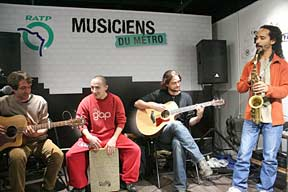 Licensed musicians playing in a Paris metro station.